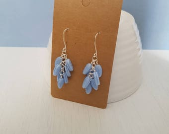 Light blue glass leaves, wire wrapped, silver plated cluster earrings.