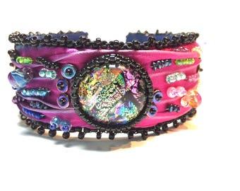 Bead embroidered shibori bangle bracelet with dichroic glass focal