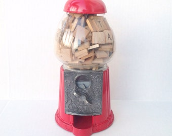 Vintage red Carousel gumball machine filled with wood Scrabble tiles.  Toys.
