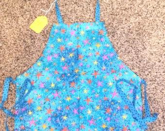 "Children's Handmade Reversible Apron or Artist Smock 20"" long, blue stars, orange flowers, apron, kitchen apron, baking apron, girl clothing"