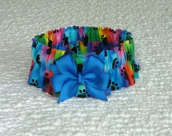 """Dog Ruffle Collar, Pet Bandana, Black Paws on Tie Dye Dog Scrunchie Collar with royal blue bow - Size L: 16"""" to 18"""" neck"""