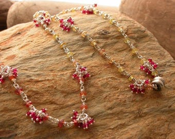 Yellow sapphire with red spinel cluster wrapped necklace Artisan Jewelry