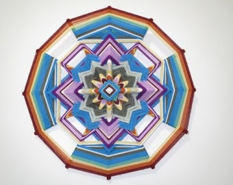Pequeña Mariposa (Little Butterfly), an 18 inch, 12-sided, all wool Ojo de Dios, in stock by S. Herbert