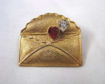 Textured gold tone envelope style brooch pin with red & crystal heart accents