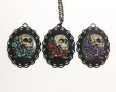 Sugar skull and roses cameo necklace on 30 inch chain. Blue, red, or purple