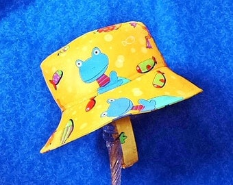 Gold Bucket Hat with Whimsical Frogs and Fish with Chin Straps