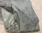 TL07.  Gunmetal Embossed Sonic Swirl Leather Cowhides