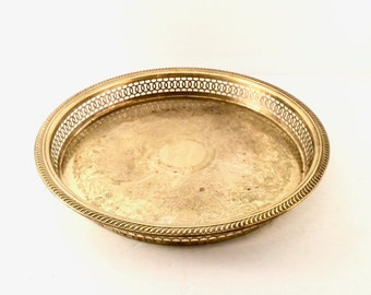 Round Brass Serving tray with cutout edging and embossed Floral design