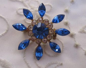 Vintage Gold Tone Starburst Shaped Brooch with Royal Blue and Clear Rhinestones