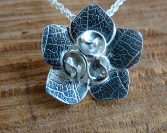 Rose flower pendant with leaf texture: Handmade, sterling silver