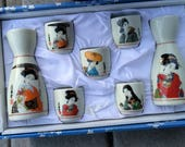 MCI Japan Saki Set White Porcelain Bold Colors Geisha Girls 2 Small Saki Servers and 5 Cups Made in Japan Pretty Saki Set in Original Box