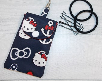 Cutie Pie Pouch • Jujube • tokidoki • Hello Kitty Out to Sea • Credit Cards • Chap Stick • Earbuds • Keys • Hand Sanitizer • READY TO SHIP!