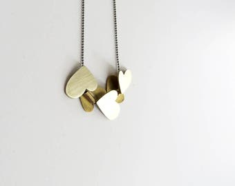 Group of 5 gold plated brass hearts pendant
