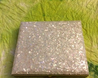 Compact with mother of pearl confetti top.