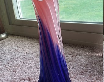 Vintage red, white and blue vase.  Top of vase looks like a pair of lips.  I love this vase it is very pretty.