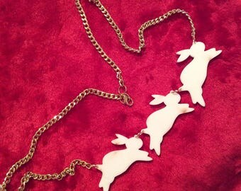 Big bunny necklace: 3 white rabbits on goldtone chain