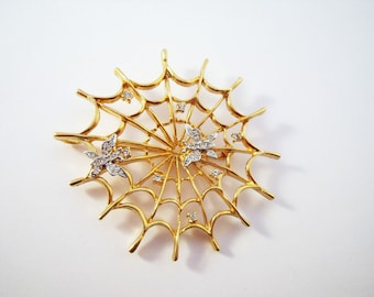 Spider web brooch