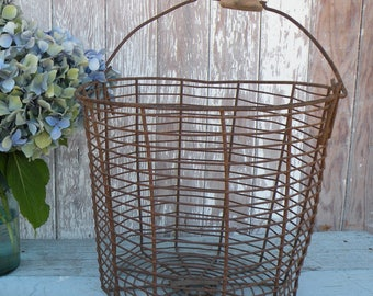 Excellent vintage egg basket,  wire with handle , Spider web bottom , Old Wood handle , Rusted Farmhouse Goodness