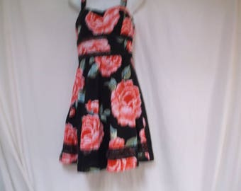 Brightly Colored Floral Sundress, Made in Mexico.  Red flowers, green leaves on a black background.  100% Polyester, Size 8