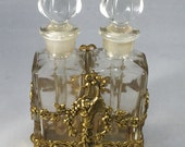 Vintage ornate gold metal base with square glass perfume bottles
