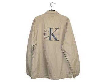 Vintage Calvin Klein Jeans Large CK Logo 100% Nylon Button Up Collared Jacket - Medium