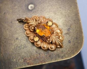 Vintage filigree pendant with glass rhinestones