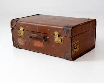 vintage suitcase with travel stickers, brown leather luggage