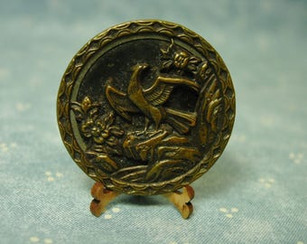 "Antique Metal Picture Button,Bird with Wings Spread, Flowers, 1 3/8"", Back Marked"