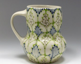 Handmade Wheel Thrown Ceramic Mug with Kiwi, Navy and Dark Green Pattern