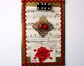 BURNING HOLY ROSES---original collage on book back; found objects, red, valentine, gift, Rilke, poetry, heart, gold, black and white, roses