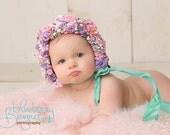 Flower bonnet, sitter size infant bonnet