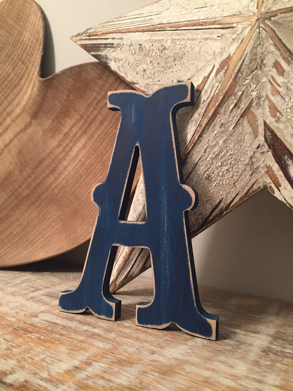 Letter A in Circus Font - shown in Navy with a distressed finish.