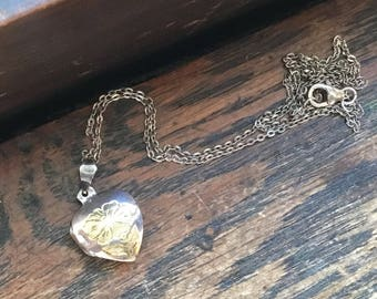Sterling silver heart flower locket
