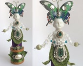 ON HOLD...........mixed media assemblage art doll, BUTTERFLY art, flower child, altered art doll, by Elizabeth Rosen