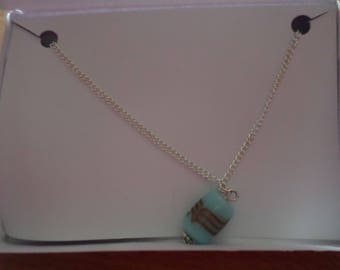 Pale blue and gold necklace