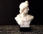 White Resin Bust on a Black Marble Pedestal