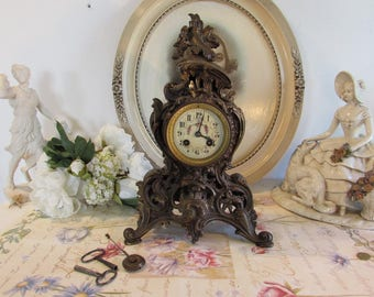 Superb French large imposing mantle clock with exquisite enamel face.