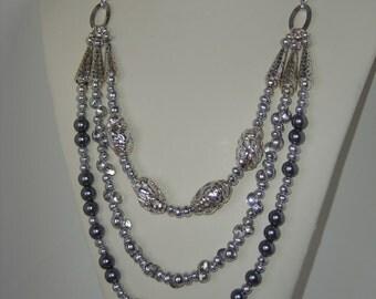 Triple strand statement necklace