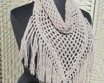 Beige crochet neckwarmer/cowl with fringes.