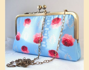 clutch bag with chain shoulder strap, handmade with red roses on blue digital print, evening purse with optional personalisation