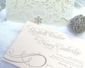 Fully customizable laser cut winter wedding invitation with rhinestone snowflake bling.