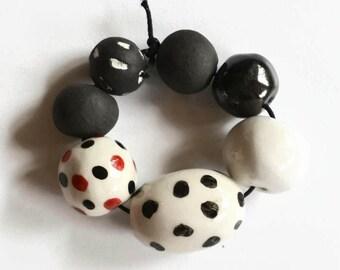 Black beads, black, red and white beads, artisan beads, Beads, ceramic beads, African beads, focal bead, oval bead, 7 clay beads, raku