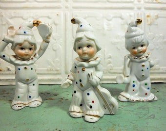 Three Vintage White and Gold Clown Figurines, Child Clowns with Musical Instruments