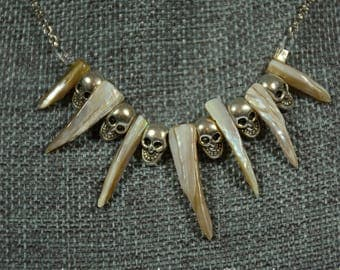 Shell Monster Necklace, spike shells with skulls