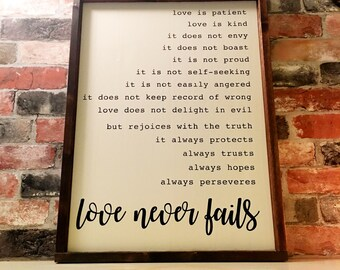 Love never fails painted wood sign