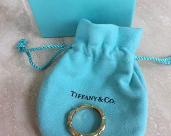 Rare, Pristine and Exquisite TIFFANY & CO 18k (750) Signature Eternity Ring Circa 1992 4mm in Width and Weight is 5 grams Size 7.5 - 7.75