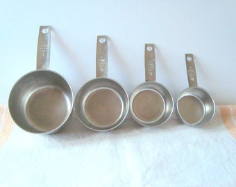 Vintage Foley stainless steel measuring cups