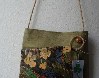 A handmade purse/bag with manually flower painting