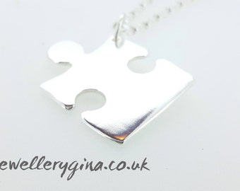 Personalised sterling silver puzzle piece necklace. Jigsaw necklace personalised in solid silver.