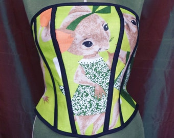 Stunning lime green mouse corset made from vintage linen fabric lined in soft pink spot cotton boned with a ribbon back. UK 14 to 16